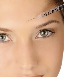 Glabella (frown between brows)
